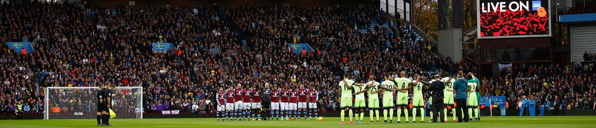 Aston Villa and Manchester City players observe a moment of silence before their match on 8 November 2014.