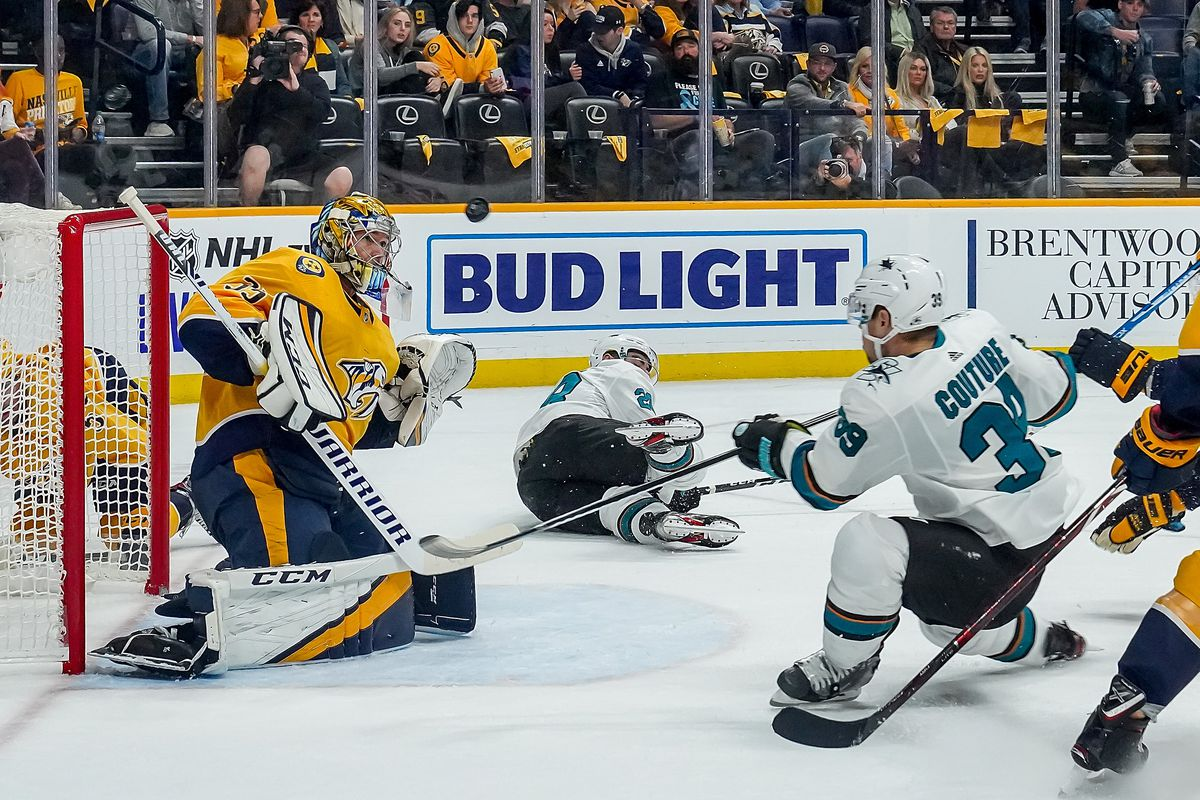 Pekka Rinne #35 of the Nashville Predators makes the save against Logan Couture #39 of the San Jose Sharks at Bridgestone Arena on October 8, 2019 in Nashville, Tennessee.