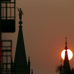 The sun sets behind the LDS Church's Salt Lake Temple as smoke engulfs the Wasatch Front on Wednesday, Sept. 6, 2017, as the Western states endure an active fire season.