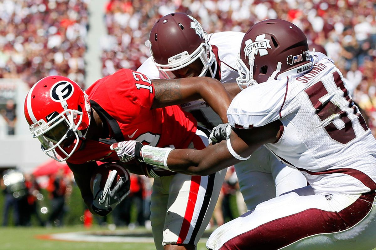 ATHENS, GA - OCTOBER 01:  Deontae Skinner #51 and Johnthan Banks #13 of the Mississippi State Bulldogs tackle Tavarres King #12 of the Georgia Bulldogs at Sanford Stadium on October 1, 2011 in Athens, Georgia.  (Photo by Kevin C. Cox/Getty Images)