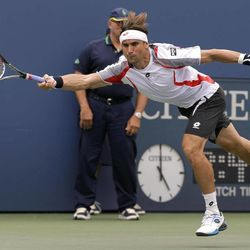 Spain's David Ferrer returns a shot against Janko Tipsarevic of Serbia in the quarterfinals during the 2012 US Open tennis tournament,  Thursday, Sept. 6, 2012, in New York.