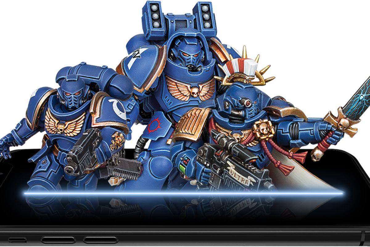 Ultramarines emerge from a phone.