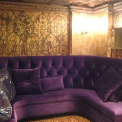 SAX offers a more private lounge area on the second floor with purple velvet banquettes