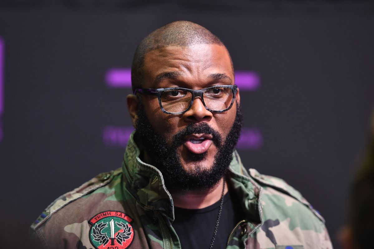 A picture of Tyler Perry wearing a camouflage military-style jacket.