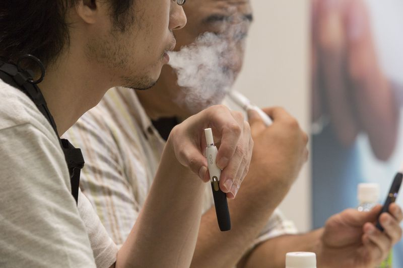 IQOS, A NEW KIND OF HEAT-NOT BURN CIGARETTE BY PHILLIP MORRIS, HAS GAINED POPULARITY IN JAPAN.