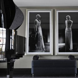 This  Friday, March, 16, 2012 photo shows reception room with baby grand piano and large desk in one of the five bedroom luxury penthouse apartments overlooking Hyde Park, London which is available for hire during the London 2012 Olympics for some 11,000 British pounds (US$17,600) a night - and includes a maid a butler and and Aston Martin car.
