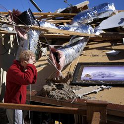 Carole Beckett reacts as she sorts through belongings at her home after a tornado moved through Woodward, Okla., Sunday, April 15, 2012.  Residents of several states scoured through the wreckage of battered homes and businesses after dozens of tornadoes blitzed the Midwest and Plains Saturday night.