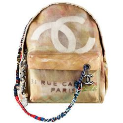 Call it the leader of the 'pack: <b>Chanel</b> paraded its graffiti-printed canvas backpack down the spring 2014 runway before it was seen on big-time blogger The Blonde Salad (previous image) and celebrities ranging from Miley Cyrus to Gwyneth Paltrow (o