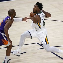 Utah Jazz guard Donovan Mitchell (45) gets ready to shoot as Phoenix Suns guard Chris Paul (3) guards him during a preseason NBA game at the Vivint Smart Home Arena in Salt Lake City on Monday, Dec. 14, 2020. The Jazz beat the Suns 111-92.