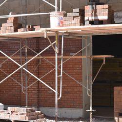 10:30 a.m. Red brick work on exterior bleacher wall on Sheffield -