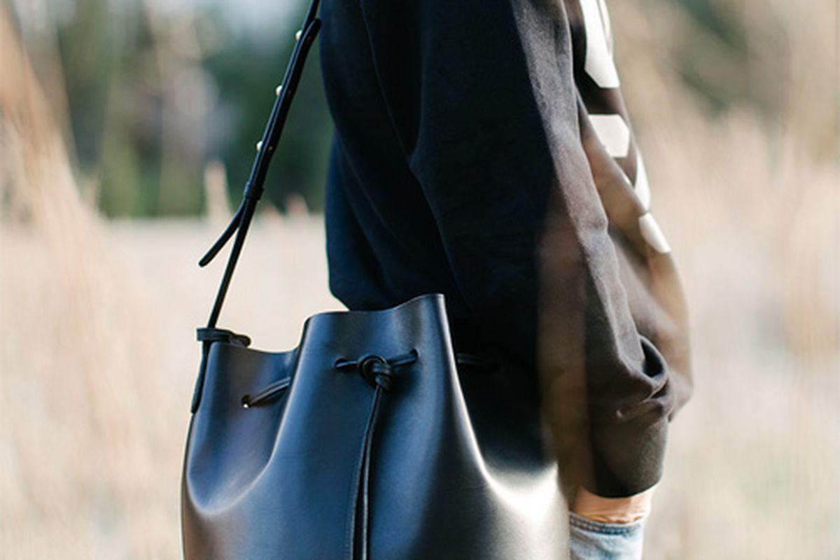 "Mansur Gavriel bucket bag, <a href=""http://www.mansurgavriel.com/products/bucket-bag-black/flamma"">$495</a>. Image <a href=""http://www.andyheart.com/2014/04/yosemite.html"">via</a>."