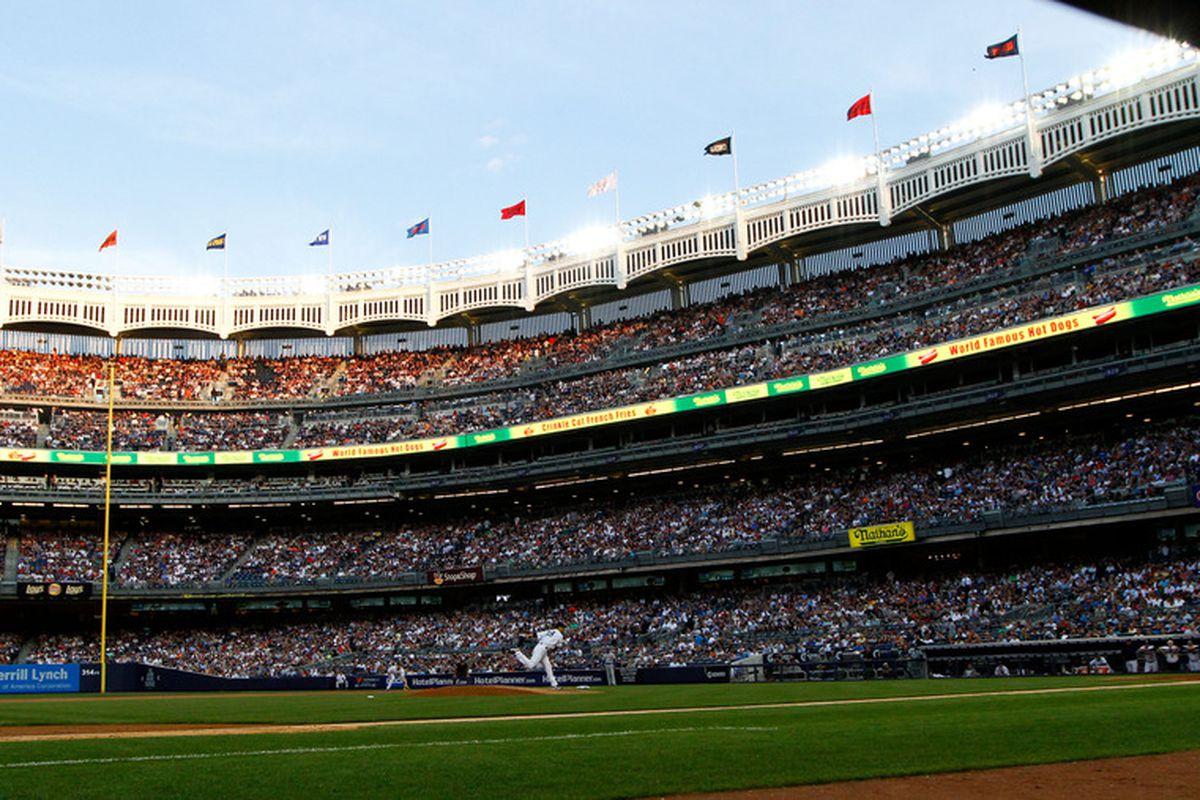 June 8, 2012; Bronx, NY, USA; New York Yankees starting pitcher Hiroki Kuroda (18) pitches against the New York Mets during the third inning at Yankee Stadium. Yankees won 9-1. Debby Wong-US PRESSWIRE
