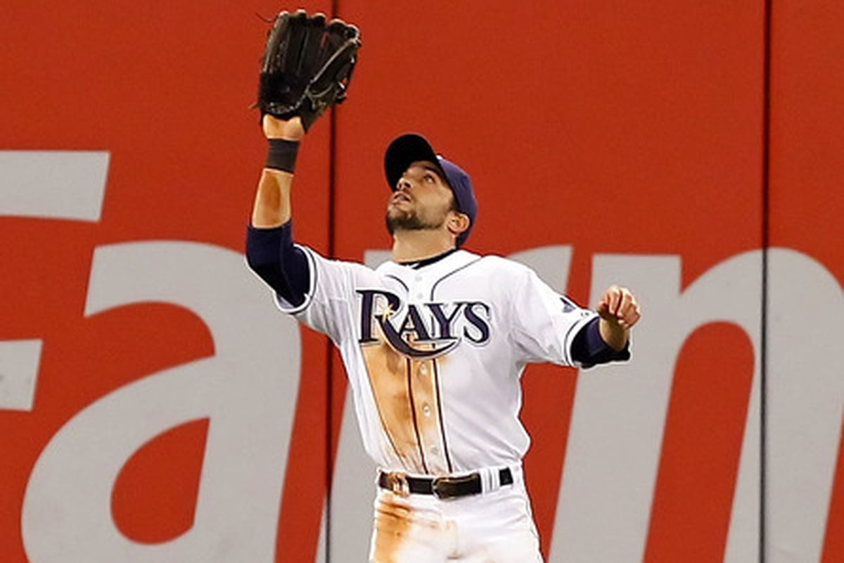 Outfielder Sam Fuld of the Tampa Bay Rays catches a fly ball against the Chicago White Sox during the game at Tropicana Field on April 18, 2011 in St. Petersburg, Florida.  (Photo by J. Meric/Getty Images)
