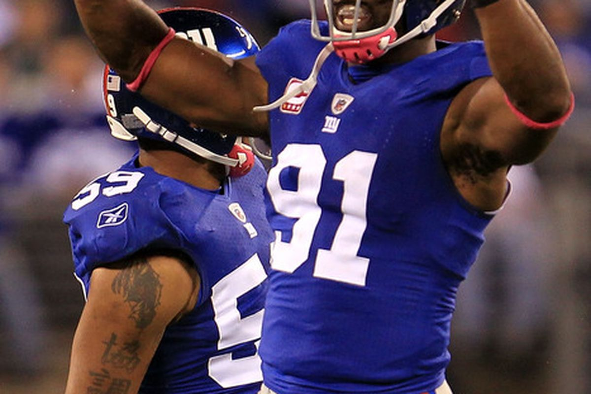 EAST RUTHERFORD NJ - OCTOBER 03:  Justin Tuck #91 of the New York Giants celebrates after the 10th sack of the game against the Chicago Bear at New Meadowlands Stadium on October 3 2010 in East Rutherford, N.J.  (Photo by Chris McGrath/Getty Images)