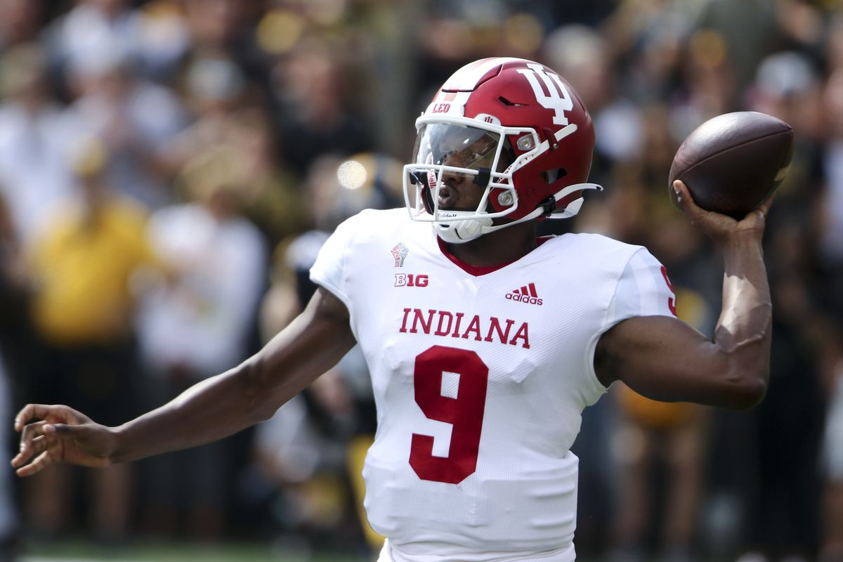 Quarterback Michael Penix Jr. #9 of the Indiana Hoosiers drops back to pass the ball during the first half against the Iowa Hawkeyes at Kinnick Stadium on September 4, 2021 in Iowa City, Iowa.