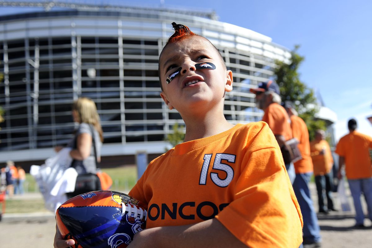 """DENVER ,CO—OCTOBER 17TH 2010— Pee Wee football player, James Gonzales, 6-years-old, outside of Invesco Field at Mile High for """"Orange Sunday"""" Sunday afternoon before the game against the New York Jets. Andy Cross, The Denver Post"""