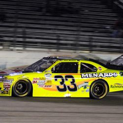 Paul Menard passes Joey Gase (39) during the NASCAR Nationwide Series auto race at Texas Motor Speedway Friday, April 13, 2012, in Fort Worth, Texas.