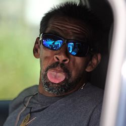 A homeless man sticks his tongue out as he is placed into a vehicle during Operation Rio Grande in Salt Lake City on Monday, Aug. 14, 2017. Lawmakers say the three-phase plan will last two years and attempt to curb crime surrounding the Road Home shelter, help those faced with addiction and homelessness, and provide training and employment to those striving to improve their lives.