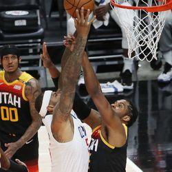 Utah Jazz center Derrick Favors (15) defends LA Clippers forward Patrick Patterson (54) during the NBA playoffs in Salt Lake City on Thursday, June 10, 2021. The Jazz won 117-111.