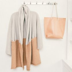"""Lauren Manoogian two-tone 'Capote' cape in putty and tan, $560; Eleven Thirty 'Naked' tote with rope handles, <a href=""""http://no6store.com/new-designers/eleven-thirty/isak-inger-naked-tote-with-rope-handles.html"""">$395</a>"""