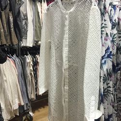 8. Maje eyelet top ($85): This top is long enough to act as a stylish cover-up or as a dress, depending on your height.