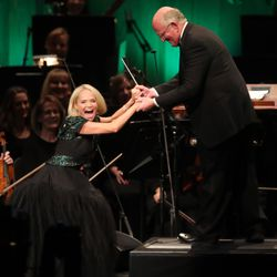 Kristin Chenoweth jokes with conductor Mack Wilberg while singing with the Tabernacle Choir at Temple Square during their opening Christmas concert in Salt Lake City on Thursday, Dec. 13, 2018.