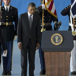 President Barack Obama pauses near the podium during the Transfer of Remains Ceremony, Friday, Sept. 14, 2012, at Andrews Air Force Base, Md., marking the return to the United States of the remains of the four Americans killed this week in Benghazi, Libya.