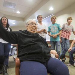 Barbara Peterson plays Wii bowling against members of the Union football team at the Uintah Basin Rehabilitation and Senior Villa in Roosevelt on Tuesday, Sept. 24, 2013. The football coaches at Union High School have taken a stand against poor performance in the classroom and bullying outside the classroom, including disrespect of teachers and students.
