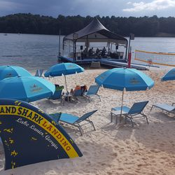 The beach greets visitors with branding galore. Wait, is that a stage on the water?