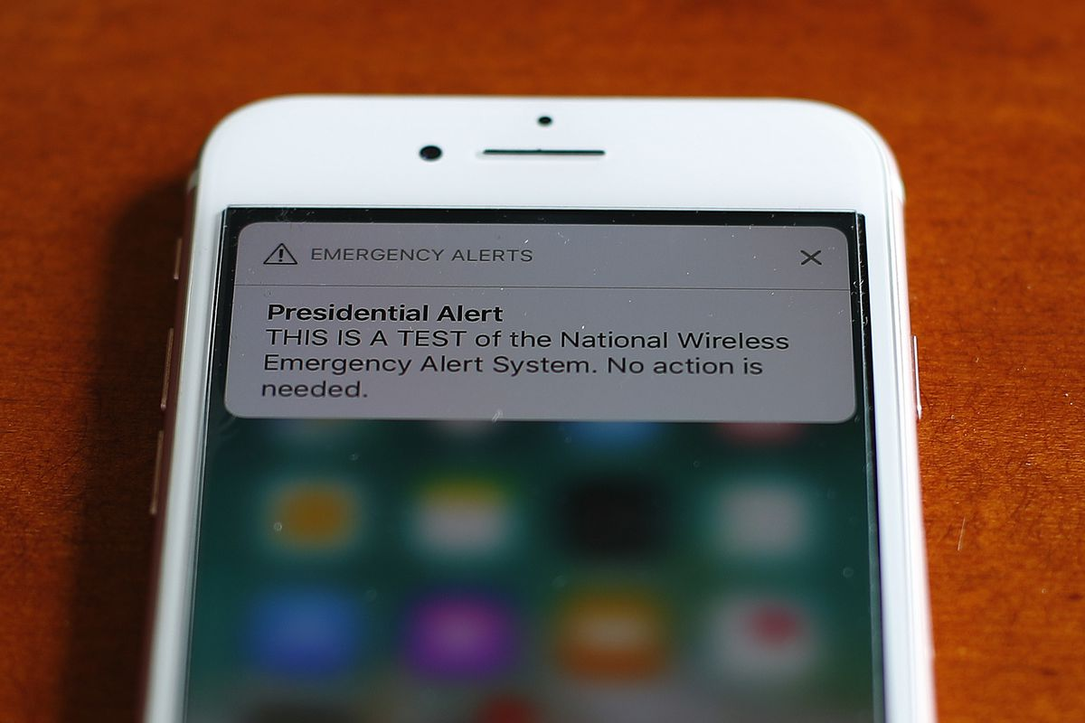The first test of the national wireless emergency system by the Federal Emergency Management Agency is shown on a cellular phone in Detroit, Wednesday, Oct. 3, 2018. About 225 million electronic devices across the United States received alerts from FEMA W
