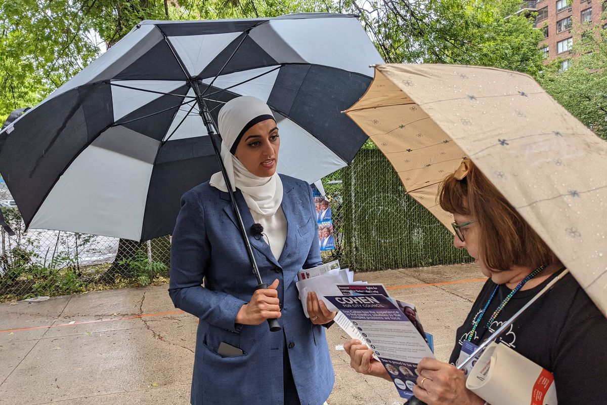 Manhattan District Attorney candidate Tahanie Aboushi speaks with a voter outside P.S. 163 on the Upper West Side Tuesday afternoon, June 22, 2021.