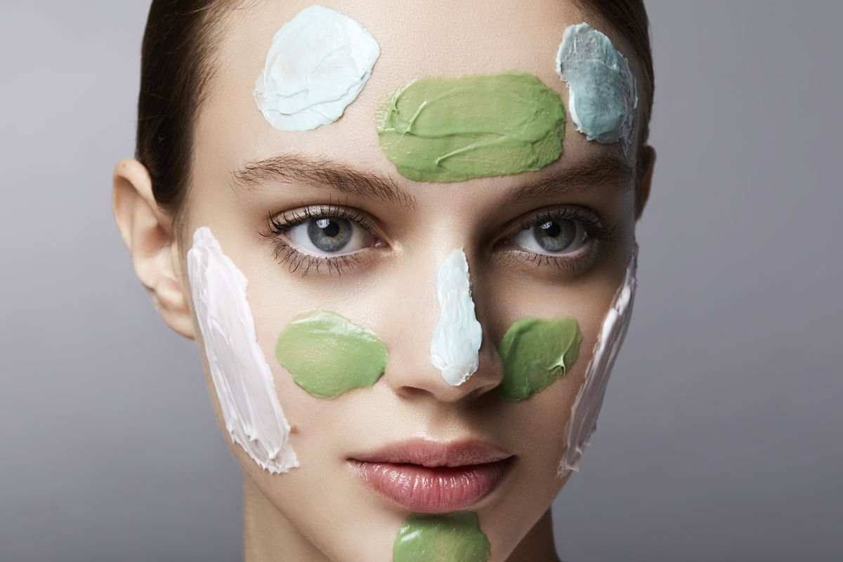 A woman wearing different colored face masks