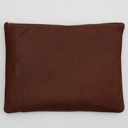 """<strong>American Apparel</strong> Large Leather Carry-All Pouch in Tan, <a href=""""http://store.americanapparel.net/product/?productId=rsalh500l"""">$56</a>"""