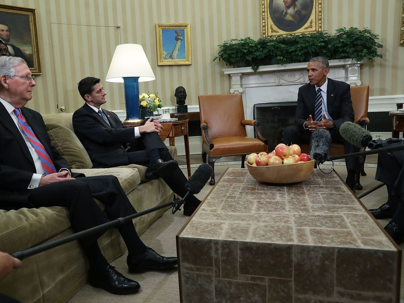 Sen. Mitch McConnell (R-KY), left, and Rep. Paul Ryan (R-WI) listen to President Barack Obama during an Oval Office meeting at the White House in 2016.