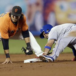 Los Angeles Dodgers' Shane Victorino, right, steals second base past the tag attempt by San Francisco Giants shortstop Brandon Crawford during the fifth inning of a baseball game Friday, Sept. 7, 2012, in San Francisco.