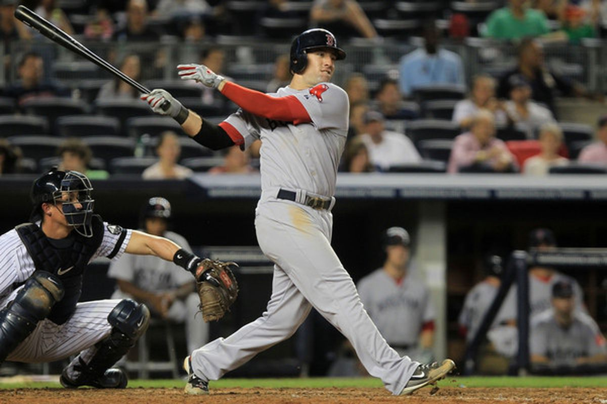 NEW YORK: Ryan Kalish #55 of the Boston Red Sox hits a double to get team mate Yamaico Navarro #56 home against the New York Yankees during their game at Yankee Stadium in the Bronx borough of New York City.  (Photo by Chris McGrath/Getty Images)