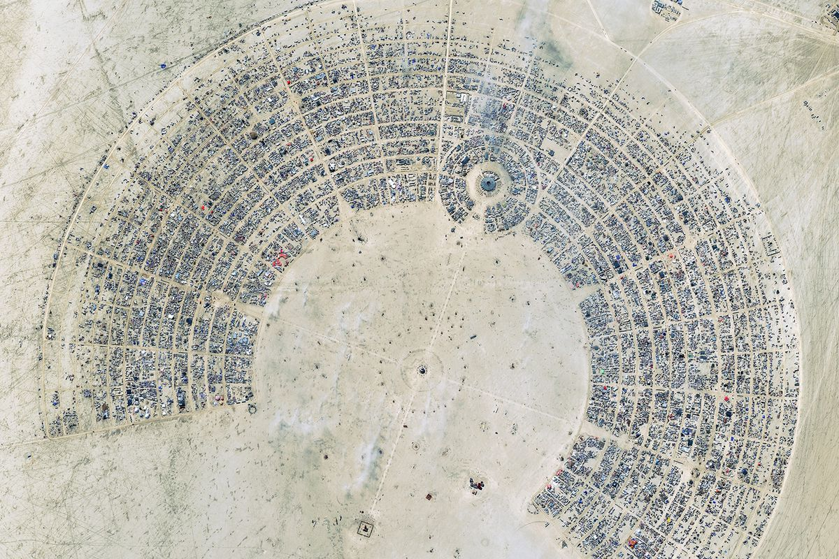 A satellite image of the Burning Man festival in Nevada, which is organized as concentric arcs with avenues emanating from the center.