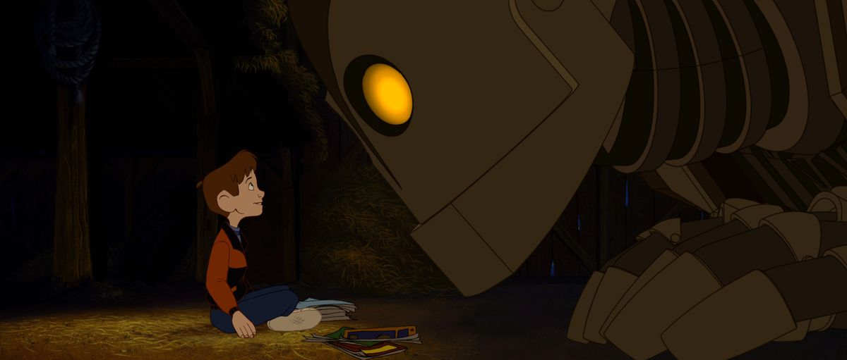 the iron giant peers at a boy