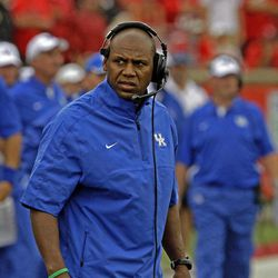 Kentucky coach Joker Phillips reacts after his team failed to make a first down against in their season-opening NCAA college football game against Louisville at Cardinal Stadium in Louisville, Ky., Sunday, Sept. 2, 2012.  Louisville won 32-14.