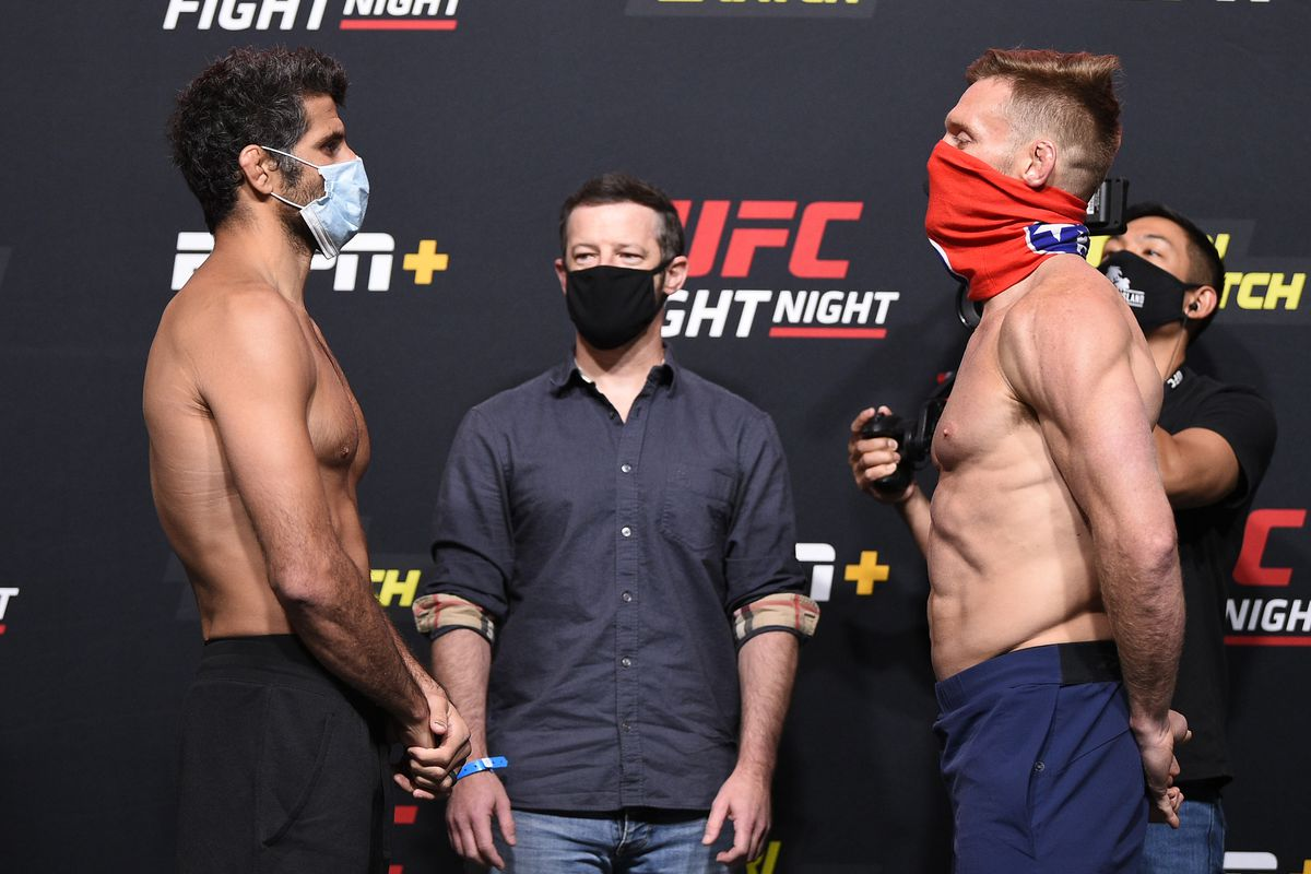Opponents Beneil Dariush of Iran and Scott Holtzman face off during the UFC Fight Night weigh-in at UFC APEX on August 07, 2020 in Las Vegas, Nevada.