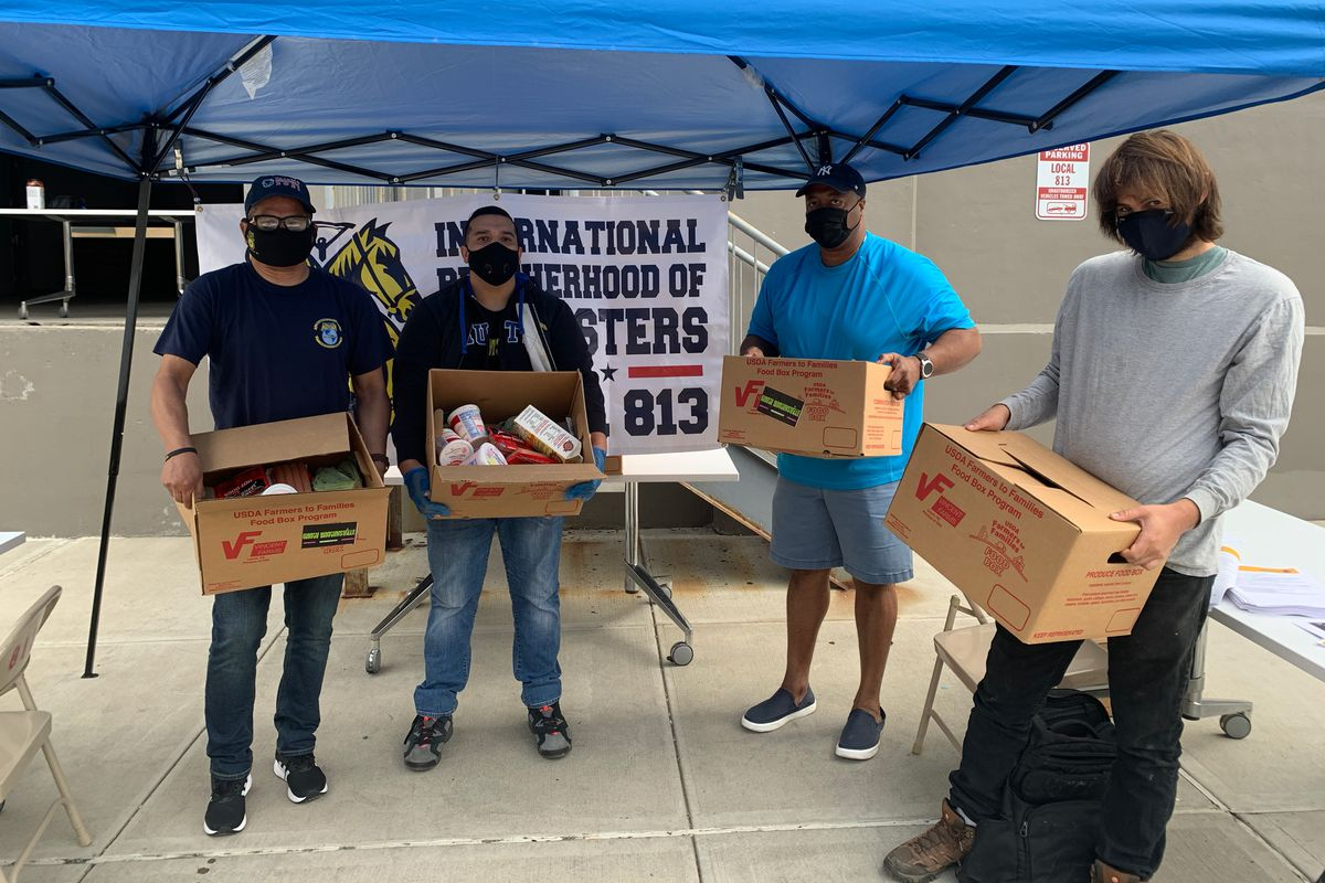 Teamsters Local 813 President Sean Campbell, second from right, takes part in a food relief event in Long Island City, Sept. 29, 2020.