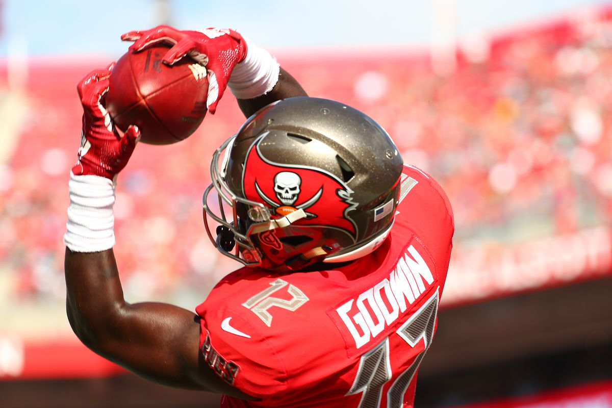 Chris Godwin #12 of the Tampa Bay Buccaneers catches a touchdown pass thrown by Jameis Winston #3 during the second quarter at Raymond James Stadium on December 02, 2018 in Tampa, Florida.