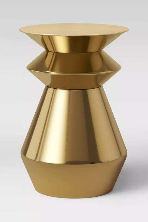 Round gold-finish stool.