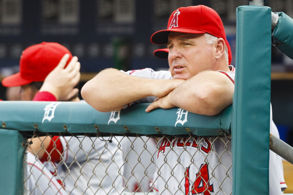 July 18, 2012; Detroit, MI, USA; Los Angeles Angels manager Mike Scioscia (14) watches from the dugout during the first inning against the Detroit Tigers at Comerica Park. Mandatory Credit: Rick Osentoski-US PRESSWIRE