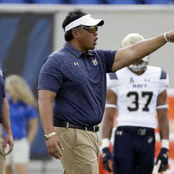 Navy head coach Ken Niumatalolo, center, watches as players warm up before an NCAA college football game against Memphis Saturday, Oct. 14, 2017, in Memphis, Tenn. (AP Photo/Mark Humphrey)