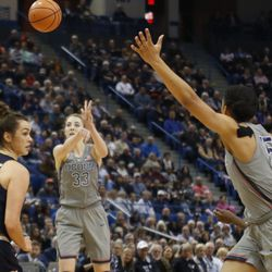 UConn's Katie Lou Samuelson (33) throws a pass to Gabby Williams (15) during the Notre Dame Fighting Irish vs UConn Huskies women's college basketball game in the Women's Jimmy V Classic at the XL Center in Hartford, CT on December 3, 2017.
