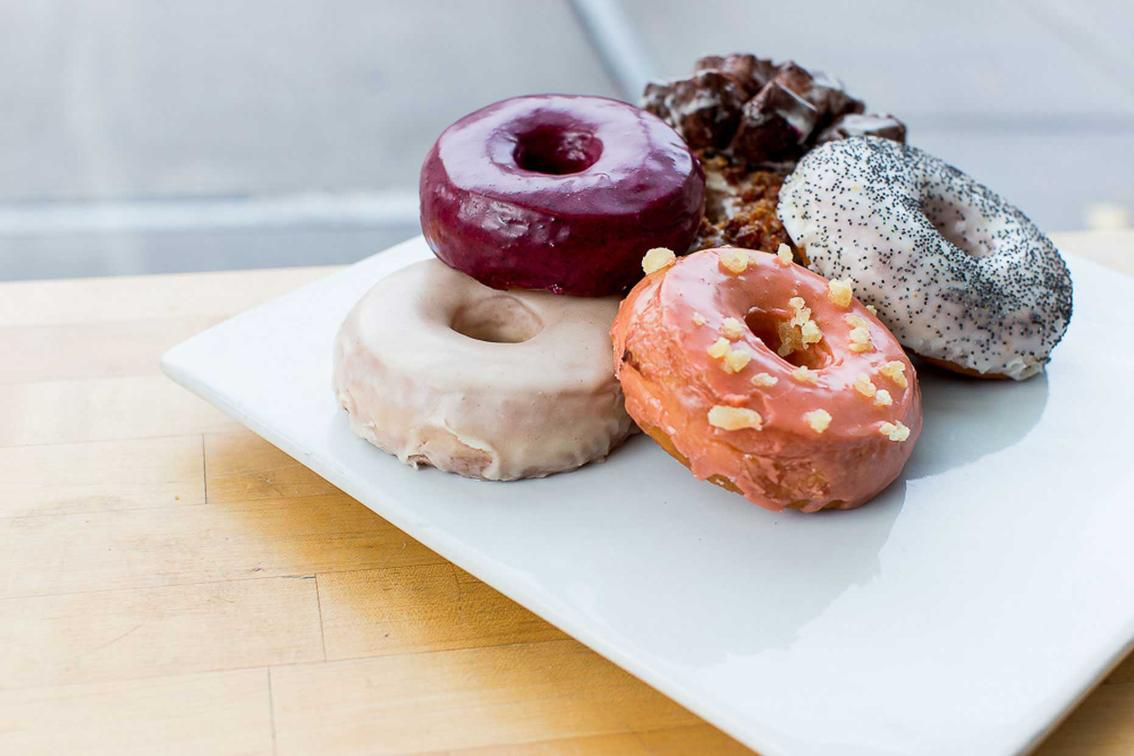 A picture of a pile of doughnuts in the window of Blue Star Donuts