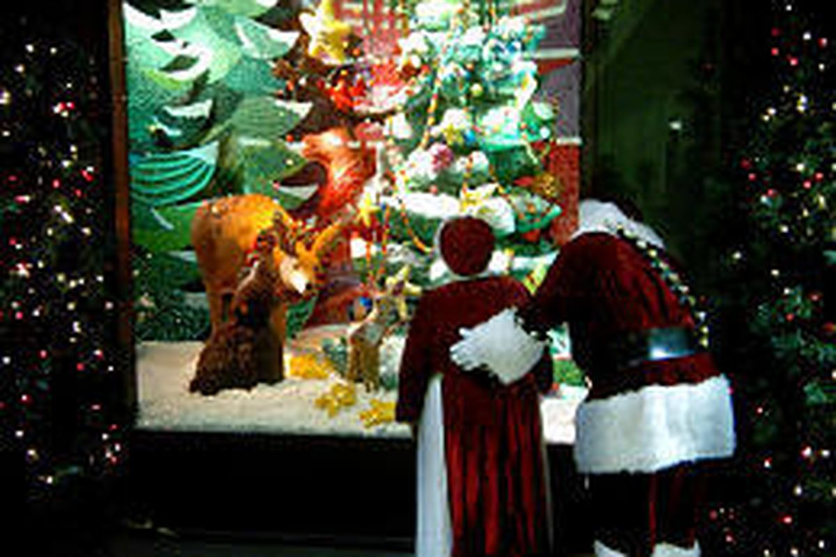 Santa and Mrs. Claus look at a Meier \& Frank candy window downtown. The windows will be officially unveiled tonight.