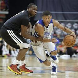 Golden State Warriors' Scott Machado, right, drives against Los Angeles Lakers' Lester Hudson in the second quarter of an NBA Summer League basketball game, Saturday, July 20, 2013, in Las Vegas.