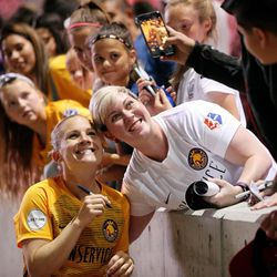 Utah Royals FC forward Amy Rodriguez (8) takes a photo with Kyleigh Weathers after a match against the Orlando Pride at Rio Tinto Stadium in Sandy on Wednesday, May 9, 2018.